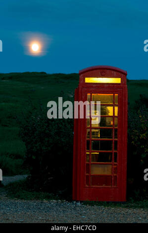 telephone box and full moon in south england, great britain, europe - Stock Photo