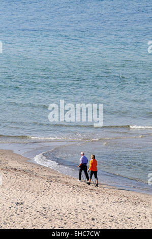 Nordic Walking Couple at the baltic sea Germany - Stock Photo