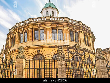 Busts of the Emperor's (or Apostles') Heads outside the Sheldonian Theatre in Oxford - Stock Photo
