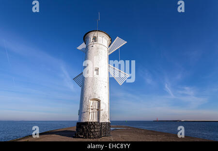 Old windmill lighthouse in Swinoujscie, Poland. - Stock Photo