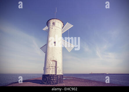 Retro vintage style photo of an old windmill lighthouse in Swinoujscie, Poland. - Stock Photo