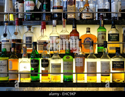 selection of scotch whisky bottles on glass shelves in bar stock photo royalty free image. Black Bedroom Furniture Sets. Home Design Ideas