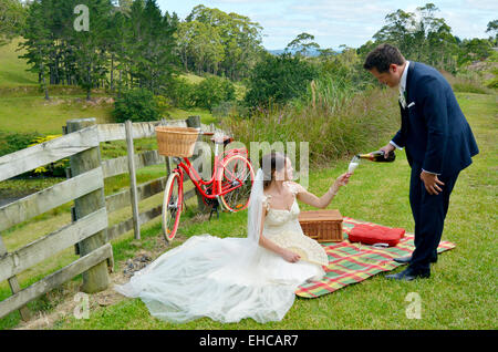 Husband and wife having a picnic in nature on their wedding Day.Concept of wedding, relationship and marriage. copy - Stock Photo