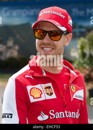 Albert Park, Melbourne, Australia. 12th Mar, 2015. Sebastian Vettel (DEU) #5 from the Scuderia Ferrari walks through - Stock Photo