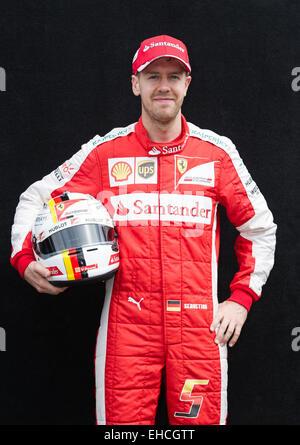 Melbourne, Australia. 12th Mar, 2015. Scuderia Ferrari Formula One driver Sebastian Vettel of Germany poses for - Stock Photo