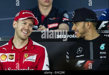 Melbourne, Australia. 12th Mar, 2015. Sebastian Vettel (L) of Germany and Lewis Hamilton of Britain attend the drivers' - Stock Photo