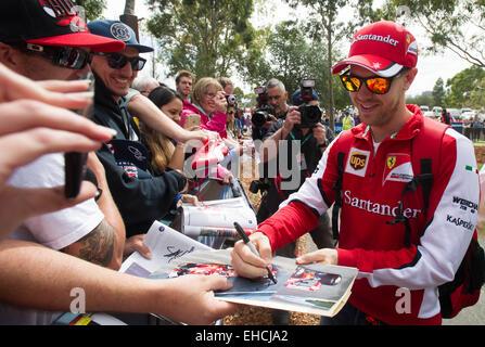Melbourne, Australia. 12th Mar, 2015. Scuderia Ferrari Formula One driver Sebastian Vettel of Germany signs autographs - Stock Photo