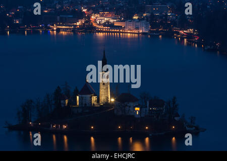 Bled city with island at dusk - Stock Photo