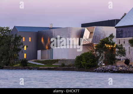 Distant view from the lake, with early morning light shimmering on the metal surface. Isabel Centre for the Performing - Stock Photo