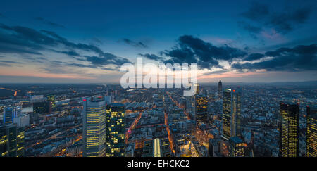 View of the city at dusk from the Main Tower with skyscrapers in the financial district, Frankfurt am Main, Hesse, - Stock Photo