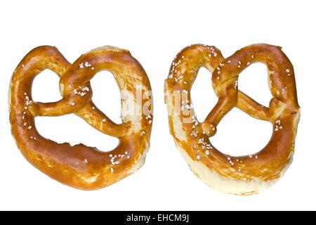 two bavarian pretzels isolated on white - Stock Photo