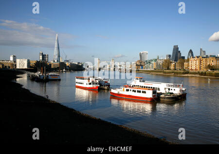 View from Bermondsey up the River Thames to Tower Bridge and the City of London, UK - Stock Photo