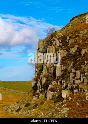 Peel Crags near Steel Rigg with a section of Hadrian's Wall visible above in Northumberland National Park north - Stock Photo