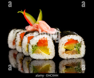 Delicious sushi rolls served on black table - Stock Photo