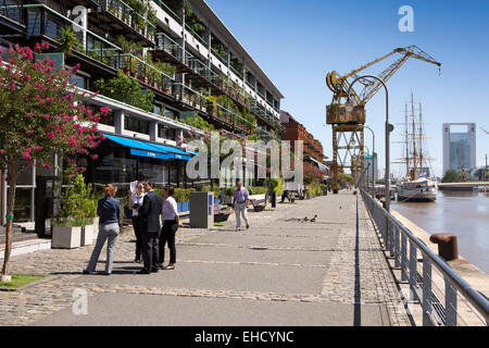 Argentina, Buenos Aires, Puerto Madero, quayside restaurants & apartments in old warehouses beside Frigate Presidente - Stock Photo