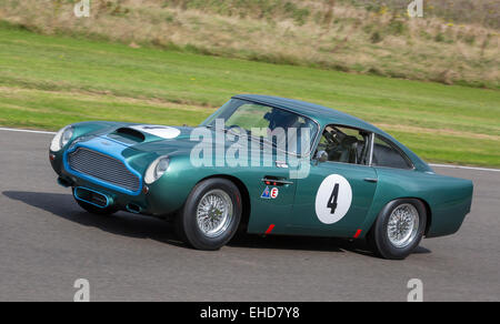 1960 Aston Martin DB4GT with driver Danny Sullivan. RAC TT Celebration race at the 2014 Goodwood Revival, Sussex, - Stock Photo