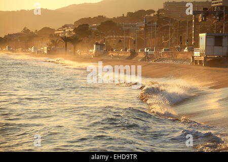 Sunset above the beach of Cannes la Bocca - Stock Photo