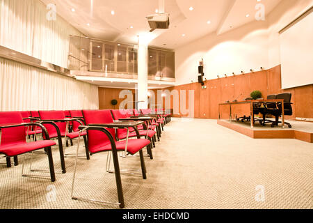 red chairs rows in conference hall - Stock Photo