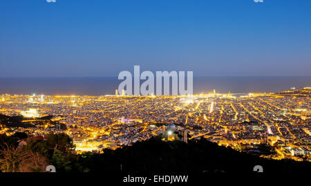Barcelona at night seen from Mount Tibidabo - Stock Photo