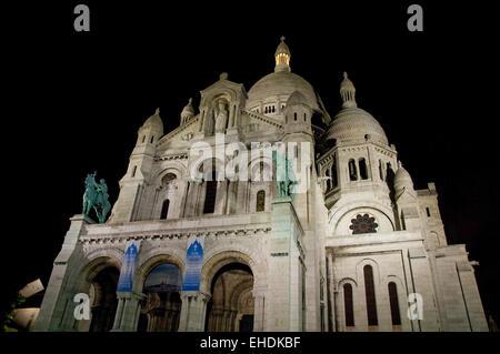 Night shot of Sacre Coeur in Paris France - Stock Photo