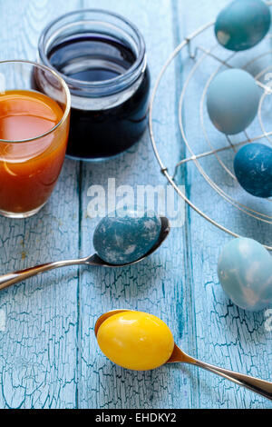 Easter eggs painted with natural dye: red cabbage and tumeric - Stock Photo