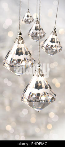 Crystal christmas ornaments against silver - Stock Photo