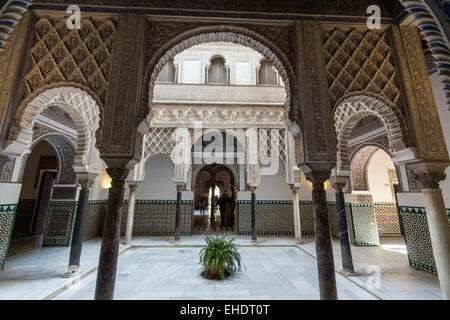 Patio de las Muñecas, Patio of the Dolls, with  beautiful decoration of tiles and stucco arabesques. - Stock Photo