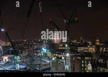 City of London EC4 skyline at night - panoramic view of cranes on the Bloomberg Building construction site and St - Stock Photo