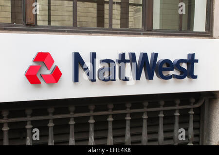 Retail banking::NatWest (National Westminster Bank) name and logo on an external wall outside the bank branch in - Stock Photo