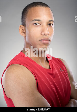 Muscular man wearing red tank top vest - Stock Photo