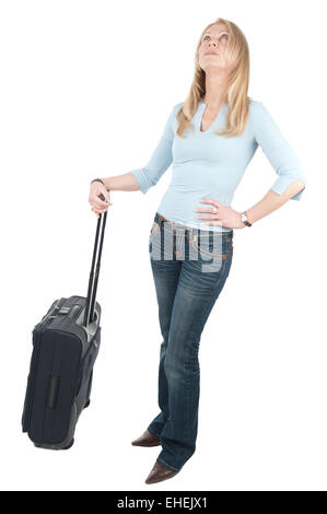 Woman is waiting with trolley bag - Stock Photo