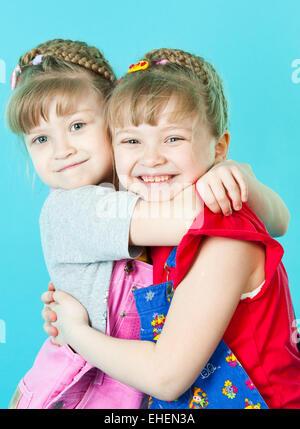 Twin sisters hugging - Stock Photo