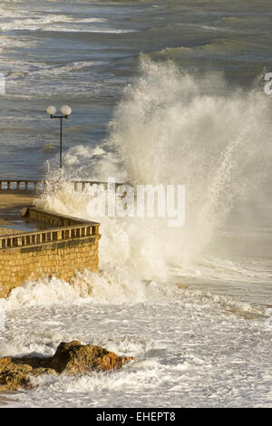 Breakers on the beach in Albufeira - Stock Photo