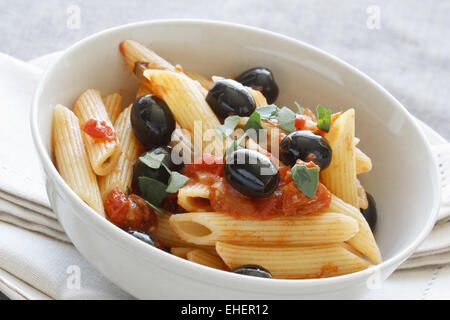 Rigatoni with Olives and Tomatoes - Stock Photo
