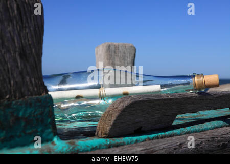 Message in a bottle on old wooden boat - Stock Photo