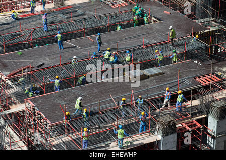 construction site of high-rise  apartment skyscraper tower in Dubai United Arab Emirates - Stock Photo