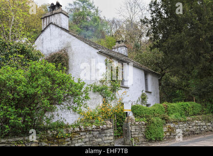 View on Dove Cottage (the home of William Wordsworth), Grasmere, near Lake Windermere, Lake District National Park, - Stock Photo
