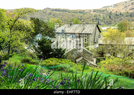 View on Dove Cottage, once the home of the poet William Wordsworth, Grasmere, Lake District Cumbria, England, UK - Stock Photo