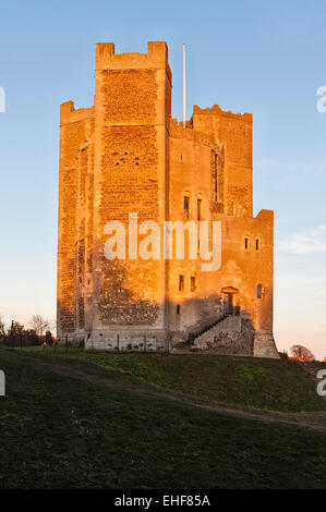 Orford Castle, Suffolk, UK, at sunset. Built about 1170, it looks over Orford Ness and out across the coast to the - Stock Photo