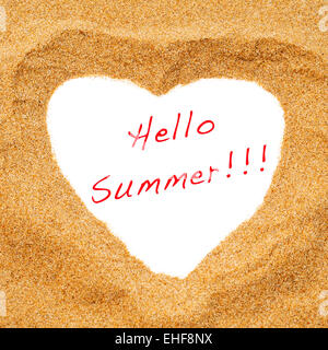 a heart drawn in the sand as a heart shaped frame with the