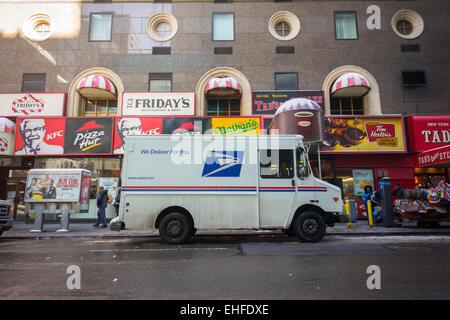 A USPS vehicle parked in New York on Friday, March 6, 2015. The USPS announced it will replace its aging fleet of - Stock Photo