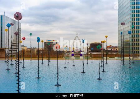 Multicolored fountain in the Esplanade De La Defense, Paris, France - Stock Photo