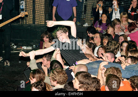 Lead singer from The Others crowd surfing at Club NME at Koko in Camden London. - Stock Photo