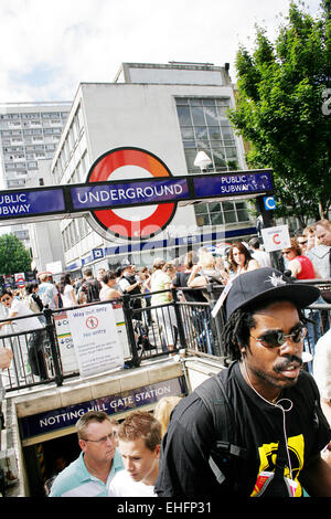 Guy coming out of Notting Hill tube station on the way to Carnival. - Stock Photo