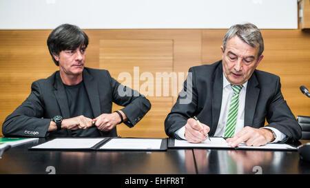 HANDOUT - FRANKFURT AM MAIN, GERMANY - MARCH 13: Joachim Loew, head coach of the German national football team (L), - Stock Photo