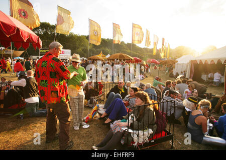 Festival goers hanging out at Bestival on the Isle of Wight. - Stock Photo