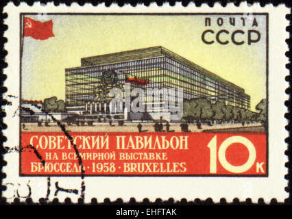 USSR - CIRCA 1958: a stamp printed in USSR shows The Soviet pavilion at the World Exhibition in Brussels - Stock Photo