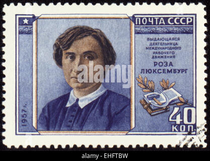 USSR - CIRCA 1957: A stamp printed in USSR shows portrait of Rosa Luxemburg - Stock Photo