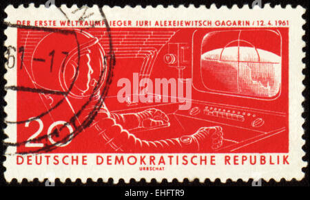 GDR - CIRCA 1961: A post stamp printed in GDR (East Germany) shows first astronaut Yuri Gagarin in spacecraft cabin - Stock Photo