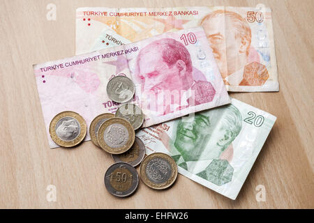 Different banknotes and coins. Turkish money on wooden table background - Stock Photo